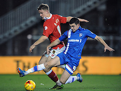 Bristol City's Matt Smith is tackled by Gillingham's John Egan - Photo mandatory by-line: Dougie Allward/JMP - Mobile: 07966 386802 - 29/01/2015 - SPORT - Football - Bristol - Ashton Gate - Bristol City v Gillingham - Johnstone Paint Trophy