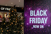 Colourful Black Friday signage at House of Fraser on Oxford Street in Londons West End on the 29th November 2019 in central London in the United Kingdom. Black Friday is a shopping event that originated from the US where retailers cut prices on the day after the Thanksgiving holiday.