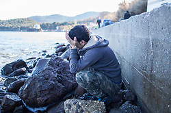 Jan. 15, 2016 - Lesbos, Greece - A refugee from Afghanistan cries after his arrival on Lesbos / Skala Skamnias, January 13, 2016. Last summer up to 120 boats arrived each day on the north-eastern coast of the Greek island of Lesvos. In winter the number reduced substantially. However the aid groups have a lot to do. The 15 kilometers broad coast is being watched permanently. When the spanish NGO Proactiva spots a boat it informs the volunteers on the coast and accompanies the refugees to the inshore. After their arrival they are checked by medics and brought in camps nearby. (Credit Image: © Bartek Langer/NurPhoto via ZUMA Press)