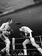 Nash vs Leon Championship Fight.    (N55)..1980..14.12.1980..12.14.1980..14th December 1980..At the Burlington Hotel, Dublin, Charlie Nash defended his European Lightweight Title when he took on Spain's Francesco Leon. .Image shows Nash preparing to throw a right as Leon ducks away.