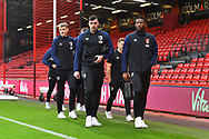 Bournemouth players including David Brooks, Diego Rico and Jefferson Lerma walking next to the pitch before the Premier League match between Bournemouth and West Ham United at the Vitality Stadium, Bournemouth, England on 19 January 2019.