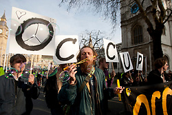 © licensed to London News Pictures. London, UK 14/03/2012. A protester is bubbling at the student demonstration against tuition fees and education cuts today in central London. Photo credit: Tolga Akmen/LNP