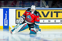 KELOWNA, BC - MARCH 11: Roman Basran #30 of the Kelowna Rockets stretches on the ice during warm up against the Victoria Royals at Prospera Place on March 11, 2020 in Kelowna, Canada. (Photo by Marissa Baecker/Shoot the Breeze)