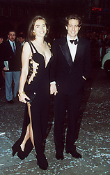 Liz Hurley and Hugh Grant at the Four Weddings and a Funeral premiere. Full length.