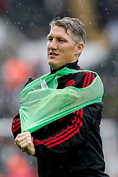 Bastian Schweinsteiger of Manchester United puts on a bib - Mandatory byline: Rogan Thomson/JMP - 07966 386802 - 30/08/2015 - FOOTBALL - Liberty Stadium - Swansea, Wales - Swansea City v Manchester United - Barclays Premier League.