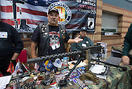 December 16th, Members of the Vietnman Veterans of America , the Westbank Chaper 553 site behind a World War ll era machine gun that was converted into an assualt reifle at the Pontchartrain Center in Kenner Louisiana held by Great Southern Gun and Knife Shows L.L. C. . Gun sales have increased since the school shooting massacre in Sandy Hook Connecticut, especially AR 15s, one of the types of guns  Adam Lanza used on his killing spree, as gun owners fear new legislature will soon regulate sales of such guns.