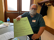 Election Clerk Dennis Plane holds up a Pennsylvania provisional ballot. Voters may be asked to fill out a provisional ballot for many reasons, including forgetting to bring a requested, absentee but not yet voted, absentee or mail-in ballot to the polling place in order to have it spoiled when coming to vote in person.
