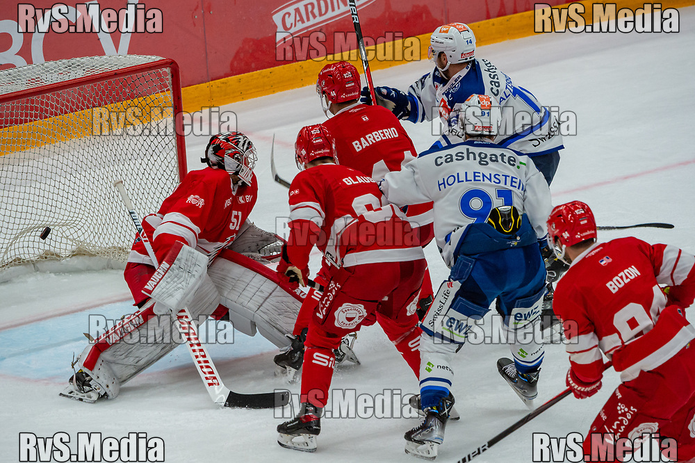 LAUSANNE, SWITZERLAND - OCTOBER 01: Chris Baltisberger #14 of ZSC Lions scores a goal against Goalie Tobias Stephan #51 of Lausanne HC during the Swiss National League game between Lausanne HC and ZSC Lions at Vaudoise Arena on October 1, 2021 in Lausanne, Switzerland. (Photo by Robert Hradil/RvS.Media)
