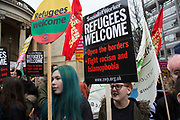 Demonstrators with Refugees Welcome placards at Anti-racism Day demonstration led by Stand Up To Racism on 19th March 2016 in London, United Kingdom. Stand Up To Racism has led some of the biggest anti-racist mobilisations in Britain of the last decade, making a stand protesting against racism, Islamophobia, anti-Semitism and fascism.