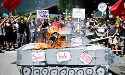 05.06.2015, Garmisch Partenkirchen, GER, G7 Gipfeltreffen auf Schloss Elmau, Circa 300 Menschen demonstrieren in Garmisch-Patenkirchen gegen den G7-Gipfel im benachbarten Elmau, im Bild Demonstranten verbrennen einen Panzer aus Pappe // during Protest of the G7 opponents prior to the scheduled G7 summit which will be held from 7th to 8th June 2015 in Schloss Elmau near Garmisch Partenkirchen. Garmisch Partenkirchen, Germany on 2015/06/05. EXPA Pictures © 2015, PhotoCredit: EXPA/ Eibner-Pressefoto/ Gehrling<br /> <br /> *****ATTENTION - OUT of GER*****