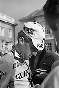 Nissan International Cycle Race..1986..01.10.1986..10.01.1986..1st October 1986..The Nissan Classic began today from Trinity College,Dublin. The offical race starter was The Taoiseach,Dr Garrett FitzGerald TD. He was accompanied by the Minister for Sport,Mr Sean Barrett TD..Sean Kelly was returning to defend his title but his opposition included Greg LeMond, the 1983 world champion and the winner of the Tour de France of the previous July. Roche was out due to his injured leg. Adri van der Poel was back with 1980 Tour de France winner and 1985 world champion Joop Zoetemelk. Teun van Vliet was back too. The winner of the green jersey of the Tour de France that July, Eric Vanderaerden was there as well as Australians Phil Anderson and Alan Peiper as well the Scottish cyclist Robert Millar...Image of Sean Kelly, in his Guinness/Kas race attire, signing autographs for the fans.