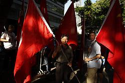 July 1, 2017 - Hong Kong, CHINA - Pro-China demonstrators display their support by exhibiting China national flags and HKSAR flags during political rally organized by pro-democratic camps to condemn visiting Chinese President Xi Jin Ping. Today marks 20th anniversary of the Hong Kongs HANDOVER to China.July 1, 2017.Hong Kong.ZUMA/Liau Chung Ren (Credit Image: © Liau Chung Ren via ZUMA Wire)