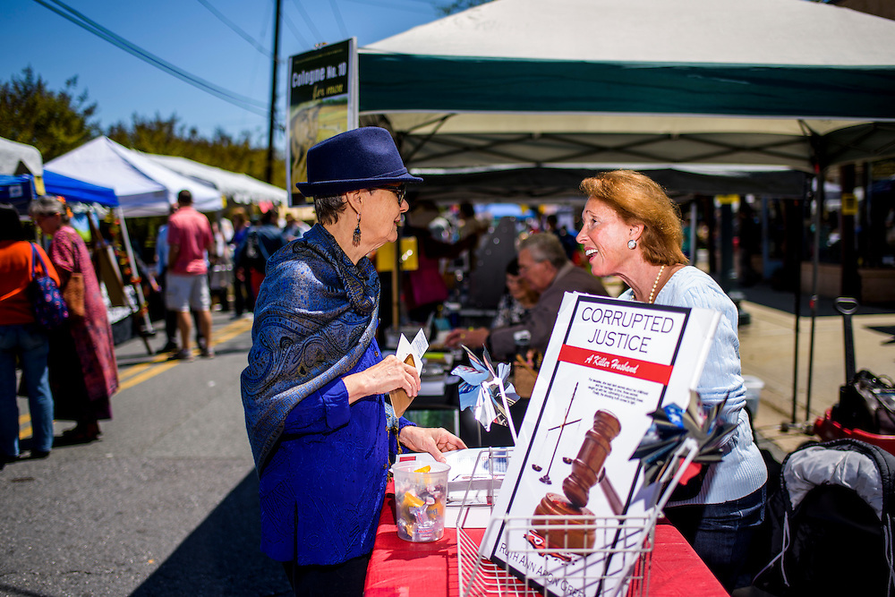 """Kensington, Maryland - April 24, 2016: Ruthann Aron Green markets her book """"Corrupted Justice -- A Killer Husband,"""" to Heide Fabiano, from Kensington, Md. during the Kensington Book Festival in Kensington, Md., Sunday April 24, 2016. <br /> <br /> Former U.S. Senate candidate, lawyer and developer Ruthann Aron Green attempts to sell her autobiography """"Corrupted Justice -- A Killer Husband,"""" at the Kensington Book Festival in Kensington, Md., Sunday April 24, 2016. <br /> <br /> In 1997 Aron Green was recorded by an undercover police officer, posing as a hit-man, soliciting the murder of her husband, a wealthy urologist, and another man. After a high-profile arrest, a mistrial, and a second court cases ending in a no-contest plea, she was jailed from 1997 to 2000 at the Montgomery County Detention Center. She blames her mental state on an abusive relationship with Barry Aron, her husband. """"I had a psychotic break resulting from 30 years of abuse and over drugging of prescription drugs by my husband."""" <br /> <br /> After years away from Montgomery County, she's returned with a self-published autobiography as part of her campaign to re open her case and attempt to clear her name. If the case doesn't go her way, she opens herself up to be convicted for attempted murder.<br /> <br /> CREDIT: Matt Roth"""