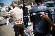 A man buys a photo of military general Sisi in Tahrir Square, Cairo.