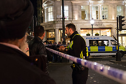 London, November 24 2017. Oxford Circus is sealed off after reports of an incident, creating havoc for traffic and underground commuters during Friday's rush hour, with police eventually standing down. Social media reports mentioned shots fired although this appears now not to be the case PICTURED: A police officer mans a cordon on Regent Street. © Paul Davey
