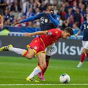 PARIS, FRANCE - September 10:   Jonathan Ikone #22 of France is tackled in the penalty area by Max Llovera #20 of Andorra during the France V Andorra, UEFA European Championship 2020 Qualifying match at Stade de France on September 10th 2019 in Paris, France (Photo by Tim Clayton/Corbis via Getty Images)