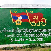 Signs commemorating the 50th anniversary of the establishment of the Lao police force. The sign is in Luang Namtha province in northern Laos.