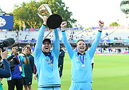 Jason Roy of England and Jos Buttler of England celebrating with the Cricket World Cup trophy on the lap of honour during the ICC Cricket World Cup 2019 Final match between New Zealand and England at Lord's Cricket Ground, St John's Wood, United Kingdom on 14 July 2019.