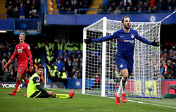 Chelsea's Gonzalo Higuain (right) celebrates scoring his side's first goal of the game during the Premier League match at Stamford Bridge, London.