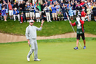 28 JUN 15 Bubba Watson drops the winning put on 18 at the conclusion of Sunday's Playoff at The Travelers Championship at TPC River Highlands in Cromwell,Conn. (photo credit : kenneth e. dennis/kendennisphoto.com)