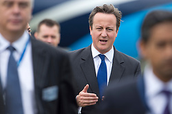 © London News Pictures. 09/07/2012. Farnborough, UK. British Prime Minister David Cameron on a walk round of aircraft on day one of the Farnborough International Airshow, in Farnborough, Hampshire, UK on July 9, 2012. FIA is a seven-day international trade fair for the aerospace industry which is held every two years at Farnborough Airport . Photo credit: Ben Cawthra/LNP.