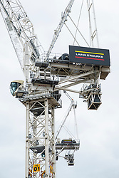 View of tower crane at construction site of new retail and commercial development at former St James centre in Edinburgh, Scotland, United Kingdom