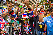 """14 JANUARY 2014 - BANGKOK, THAILAND: Anti-government protestors on Rama I Road in front of Royal Thai Police headquarters. Hundreds of protestors picketed police headquarters because they accuse the police of siding with the government during the protests. Tens of thousands of Thai anti-government protestors continued to block the streets of Bangkok Tuesday to shut down the Thai capitol. The protest, """"Shutdown Bangkok,"""" is expected to last at least a week. Shutdown Bangkok is organized by People's Democratic Reform Committee (PRDC). It's a continuation of protests that started in early November. There have been shootings almost every night at different protests sites around Bangkok, but so far Shutdown Bangkok has been peaceful. The malls in Bangkok are still open but many other businesses are closed and mass transit is swamped with both protestors and people who had to use mass transit because the roads were blocked.     PHOTO BY JACK KURTZ"""