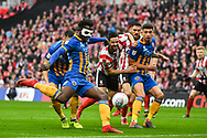 Aristote Nsiala of Shrewsbury Town (22) takes a shot at goal during the EFL Trophy Final match between Lincoln City and Shrewsbury Town at Wembley Stadium, London, England on 8 April 2018. Picture by Stephen Wright.