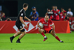 Luke Treharne of Wales in action<br /> <br /> Photographer Craig Thomas/Replay Images<br /> <br /> World Rugby HSBC World Sevens Series - Day 1 - Thursday 5rd December 2019 - Sevens Stadium - Dubai<br /> <br /> World Copyright © Replay Images . All rights reserved. info@replayimages.co.uk - http://replayimages.co.uk