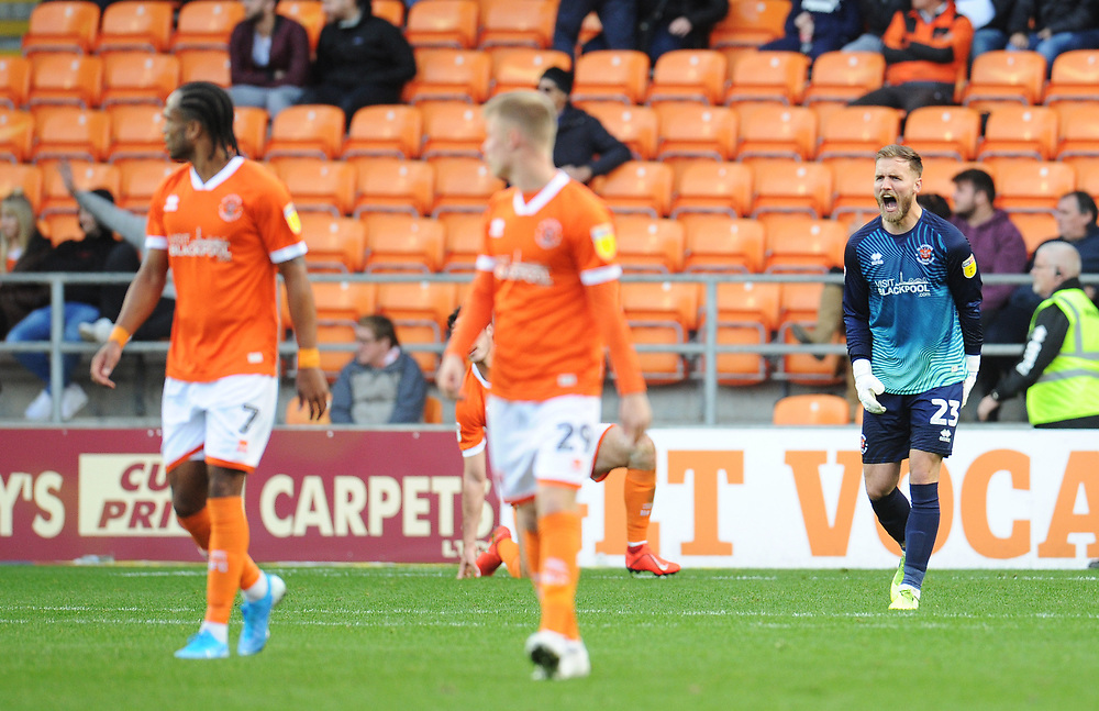 Blackpool's Jak Alnwick makes his feelings clear to team-mates after his side concede a second goal<br /> <br /> Photographer Kevin Barnes/CameraSport<br /> <br /> The EFL Sky Bet League One - Blackpool v Rotherham United - Saturday 12th October 2019 - Bloomfield Road - Blackpool<br /> <br /> World Copyright © 2019 CameraSport. All rights reserved. 43 Linden Ave. Countesthorpe. Leicester. England. LE8 5PG - Tel: +44 (0) 116 277 4147 - admin@camerasport.com - www.camerasport.com