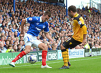 Portsmouth's Jed Wallace under pressure from Newport County's Robbie Willmott<br /> <br /> Photographer Kevin Barnes/CameraSport<br /> <br /> Football - The Football League Sky Bet League Two - Portsmouth v Newport County AFC - Saturday 30th August 2014 - Fratton Park - Portsmouth<br /> <br /> © CameraSport - 43 Linden Ave. Countesthorpe. Leicester. England. LE8 5PG - Tel: +44 (0) 116 277 4147 - admin@camerasport.com - www.camerasport.com