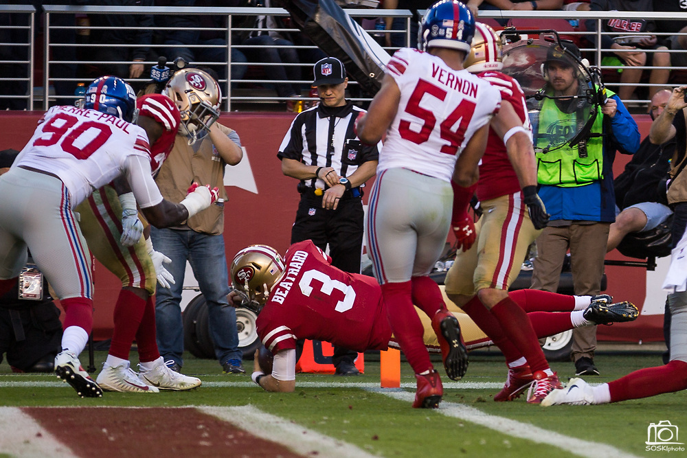 San Francisco 49ers quarterback C.J. Beathard (3) dives for a touchdown against the New York Giants at Levi's Stadium in Santa Clara, Calif., on November 12, 2017. (Stan Olszewski/Special to S.F. Examiner)