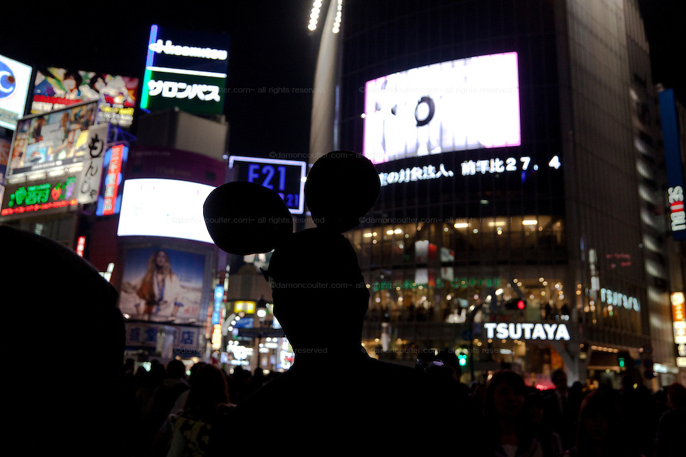 A young person wearing Mickey Mouse to celebrate Halloween in Shibuya, Tokyo, Japan. Thursday, October 31st 2013