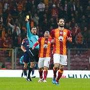 Referee's Bulent Yildirim show the yellow card to Galatasaray's Wesley Sneijder during their Turkish Super League soccer match Galatasaray between Istanbul Basaksehir at the AliSamiYen Spor Kompleksi TT Arena at Seyrantepe in Istanbul Turkey on Saturday, 14 March 2015. Photo by Aykut AKICI/TURKPIX