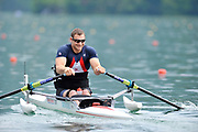 Bled, SLOVENIA, Adaptive Rowing, Tom AGGAR ASM1X, move away from the start in his heat, on the opening day, FISA World Cup, Bled venue, Lake Bled.  Friday  28/05/2010  [Mandatory Credit Peter Spurrier