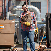 Tucson, AZ -- 09/28/2017<br /> <br /> Ramón Olivas, assistant distiller at Hamilton Distillers, chops hard mesquite wood at the Tucson-based distillery. Malt dried over mesquite fire is what makes Whiskey Del Bac Dorado so unique.<br /> <br /> Hamilton Distillers, makers of Whiskey Del Bac, is the first craft distillery in Southern Arizona since prohibition. The company produces three distinct single malt whiskeys, including Whiskey Del Bac Dorado which is malted over mesquite.<br /> <br /> The distillery offers tours and tastings on Saturdays at 3 p.m<br /> <br /> Photography by Jill Richards