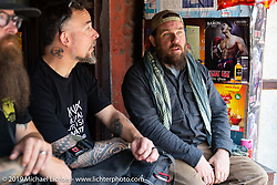 Motorcycle Sherpa's Bear Haughton and Devil Chicken artist Chris Galley at a chai stop on the Ride to the Heavens motorcycle adventure in the Himalayas of Nepal. Riding from Chitwan to Daman. Tuesday, November 12, 2019. Photography ©2019 Michael Lichter.