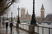 A wet day on the Southbank walkway opposite Westminster. The South Bank is a significant arts and entertainment district, and home to an endless list of activities for Londoners, visitors and tourists alike.