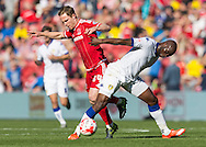 Leeds United FC defender Souleman Bamba   retains the ball from Middlesbrough FC midfielder Adam Forshaw during the Sky Bet Championship match between Middlesbrough and Leeds United at the Riverside Stadium, Middlesbrough, England on 27 September 2015. Photo by George Ledger.