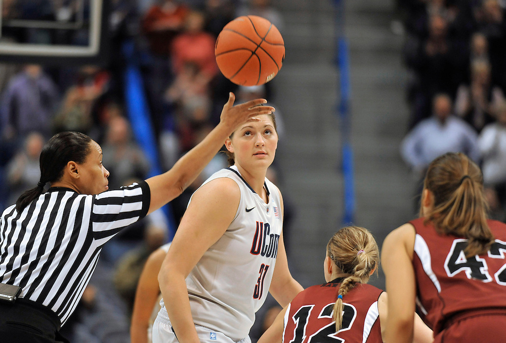 FILE- In this Nov. 10, 2010 file photo, Connecticut's 6-foot-5 freshman Stefanie Dolson preparing for tipoff during an NCAA college exhibition basketball game against Indiana of Pennsylvania, in Hartford, Conn.  Connecticut will face No. 2 ranked Baylor with Baylor's star, 6-foot-8 Brittney Griner.  (AP Photo/Jessica Hill, File)