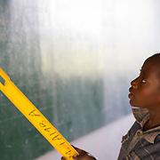 A Koumbadiouma primary school student reads from the blackboard during class. Kolda, Senegal.