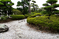 """Yugyoji Temple Garden is officially called Shojiko-ji Temple, but is much more commonly known as Yugyo-ji located in Fujisawa City near Kamakura. <br /> Yugyoji has been named as one of the """"100 Most Scenic Places in Japan"""" and also has an important historic and religious significance.  It is the headquarters of the Ji Sect, an offshoot of Pure Land Buddhism which has over 400 temples and 350,000 followers.  The main hall of the temple is a massive, beautiful building with an ornate interior and prayer area that visitors can access.  Beyond it is a beautiful and tranquil garden, filled with statues, a koi pond, and beautiful landscaping of the traditional Japanese style including a Japanese dry karesansui rock garden."""