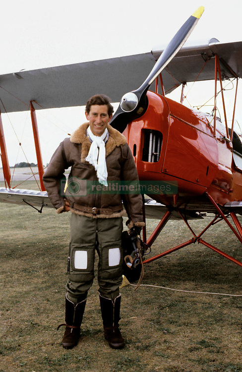 File photo dated 30/07/79 of the Prince of Wales in a Biggles-style flying outfit at RAF Benson, Oxfordshire, where he fulfilled an ambition to fly a pre-war Tiger Moth biplane.