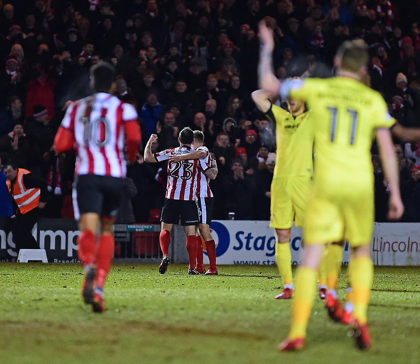 Lincoln City's Neal Eardley celebrates scoring the opening goal<br /> <br /> Photographer Andrew Vaughan/CameraSport<br /> <br /> The EFL Sky Bet League Two - Lincoln City v Cheltenham Town - Tuesday 13th February 2018 - Sincil Bank - Lincoln<br /> <br /> World Copyright © 2018 CameraSport. All rights reserved. 43 Linden Ave. Countesthorpe. Leicester. England. LE8 5PG - Tel: +44 (0) 116 277 4147 - admin@camerasport.com - www.camerasport.com