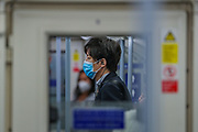People wearing face protective masks are seen commuting on a Jubilee line train in London on Sept 12, 2020. The Government enforced a new law which makes it mandatory to wear protective face masks on all public transport to help stop the transmission of COVID-19 in the UK. The British government's scientific advisory board announced on Friday that the reproduction number of coronavirus transmission across the UK was now over 1.0. The Science and the Scientific Advisory Group for Emergencies (SAGE) said the R-value was now between 1.0 and 1.2. (VXP Photo/ Vudi Xhymshiti)
