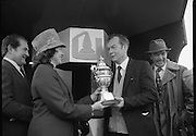 """Jameson Gold Cup At Punchestown.     (N72)..1981..29.04.1981..04.29.1981..29th April 1981. .The Jameson Gold Cup at Punchestown,Naas ,Co Kildare,was won today by """"Owens Image"""" owned by Mrs Rosemary Garvey. The horse was ridden by Mr F Berry and was trained by Mr P Hughes. Mrs Betty Bohan,wife of Mr Eddie Bohan,Past President,Vitners Federation of Ireland,made the presentation of The Gold Cup after the race..Image shows Mrs Betty Bohan presenting the Gold Cup to Mr Eugene Garvey,husband of the owner of """"Owens Image"""", Mrs Rosemary Garvey. Included in the image is Mr Eddie Bohan."""