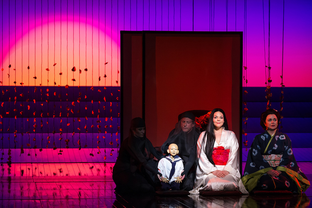"""LONDON, UK, 14 May, 2016. Rina Harms (second from right, as Butterfly) and Stephanie Windsor-Lewis (right, as Suzuki) rehearse with members of the cast for the revival of director Anthony Minghella's production of Puccini's opera """"Madam Butterfly"""" at the London Coliseum for the English National Opera. The production opens on 16 May. Photo credit: Scott Rylander."""