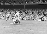 Down slides into Dublin as he runs to the ball before the Kerry v Dublin All Ireland Senior Gaelic Football Final in Croke Park on the 24th of September 1978. Kerry 5-11 Dublin 0-9.