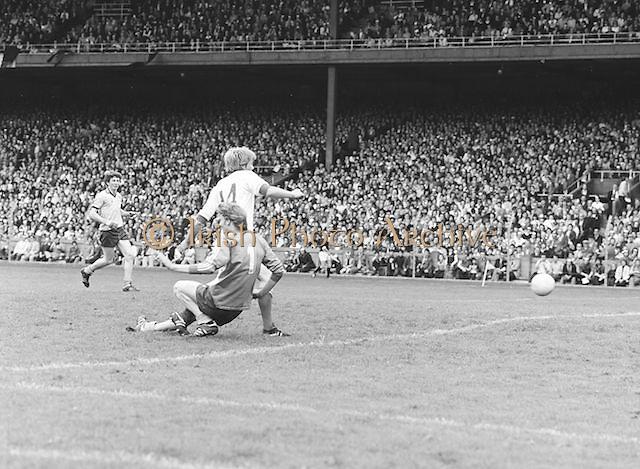 Down slides into Dublin as he runs to the ball before the Kerry v Dublin All Ireland Senior Gaelic Football Final in Croke Park on the 24th of September 1978. Kerry 5-11 Dublin 0-9.