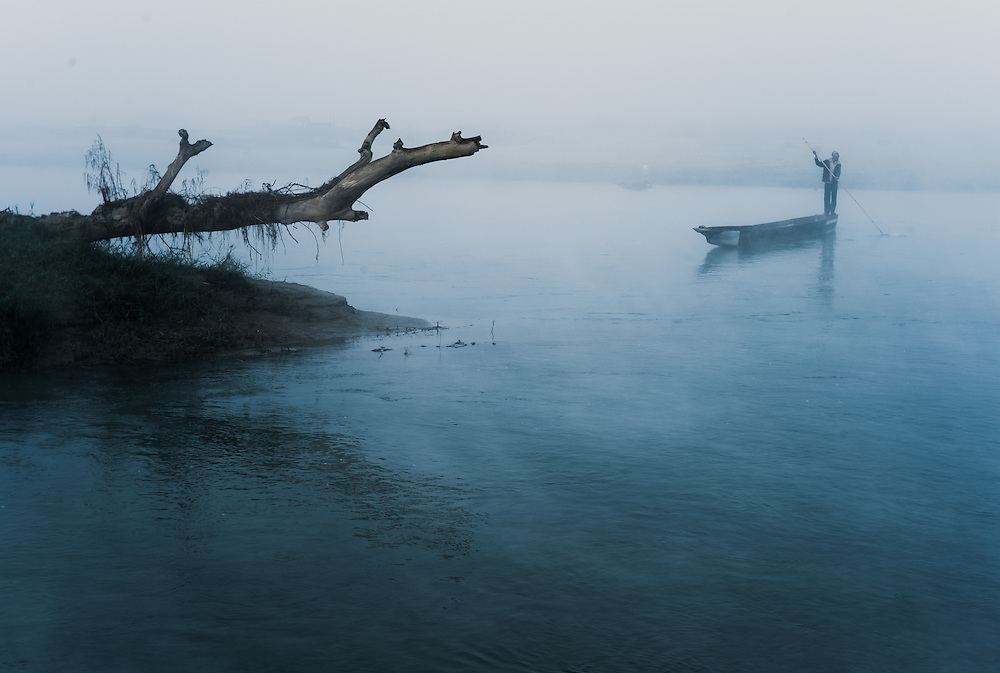An early morning river boat comes into the beach at Chitwan. River excursions and jungle treks are a main source of employment for locals.